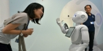 pepper_robot_with_woman-1.jpg